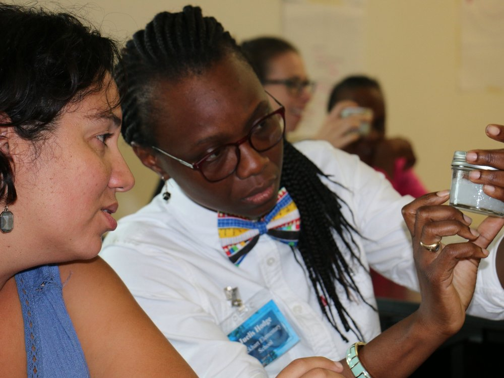 Participants at a marine debris workshop get a close up look at microplastics.