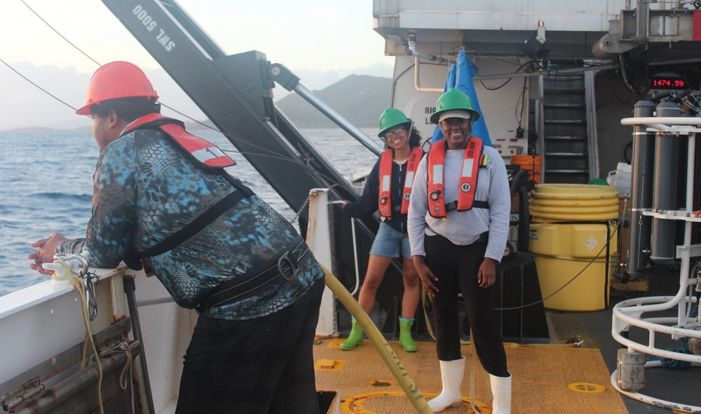 Onboard the NOAA research vessel Nancy Foster, Zola is seen here with Dr. Sennai Habtes, Research Assistant Professor of Biological Oceanography at UVI (at left).  Photo: Vanessa McKague