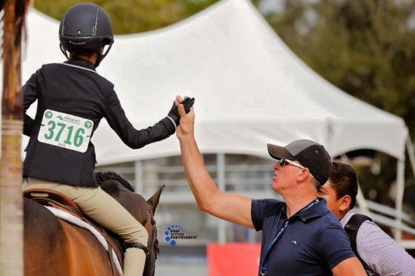 Freddie Vazquez praises Chloe Jhin on a job well done. Photo by Anne Gittins Photography