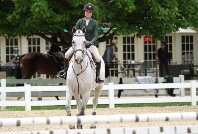 "Adult Equitation 3'    Alexandra Maracic showing At Last.   ""He's a really super horse, very adjustable and he felt great both days,"" said Alexandra Maracic. ""For equitation, I like to focus a lot on my position, keeping my back straight and not landing with my eyes down. I thought I improved on that a lot. He's really easy to stay with, really comfortable, so there wasn't really much for me to do. He just pilots me around."""