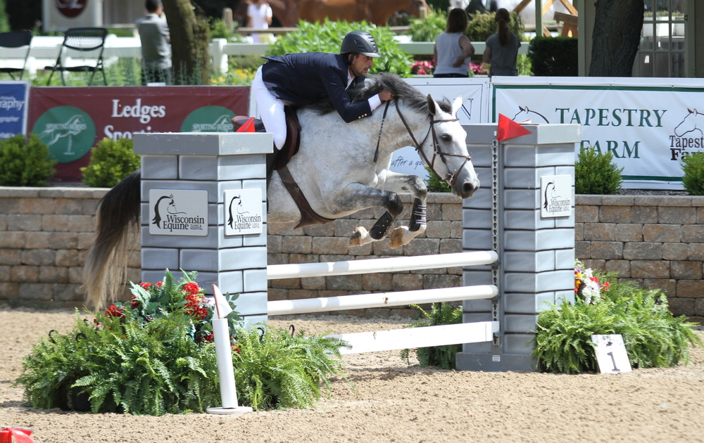 $2,500 Modified Adult Jumper Classic   Presented by Wisconsin Equine Nathan Rolfe and Altius, owned by Haley Rolfe, won theclass for the second consecutive week