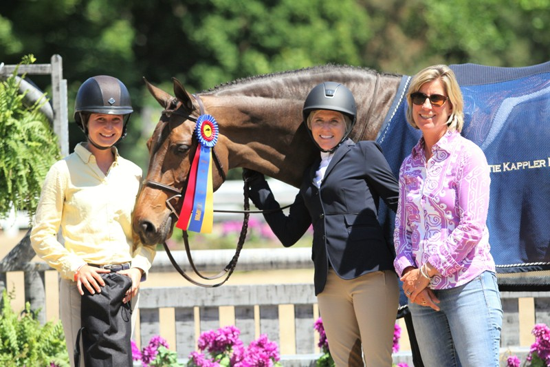 "From left, professional rider Savannah Talcott, Kiersten Litzsinger and head trainer Katie Kappler with Baroness Blixen.   Amateur Adult Hunter 36-49 Division Champion  Baroness Blixen and her owner/rider, Kiersten Litzsinger, succeeded in the Adult Hunter 36-49 as the division champions. ""She is the love of my life,"" Litzsinger said. ""I want to put her in my backyard, but  they  won't allow it. We're very connected, we're good friends. She got hurt after a year of the pre-greens, and she was out for a year. So, I just savor every moment that she's going and healthy. She was brand new to hunters at the time I had got her. That was five years ago this month. I've had many people try to buy her and I will not ever give her up."""