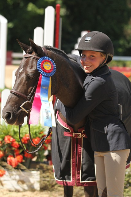 $2,000 Small Pony Hunter Division Champion Benlea Mizzou, owned and ridden by Olivia Markman