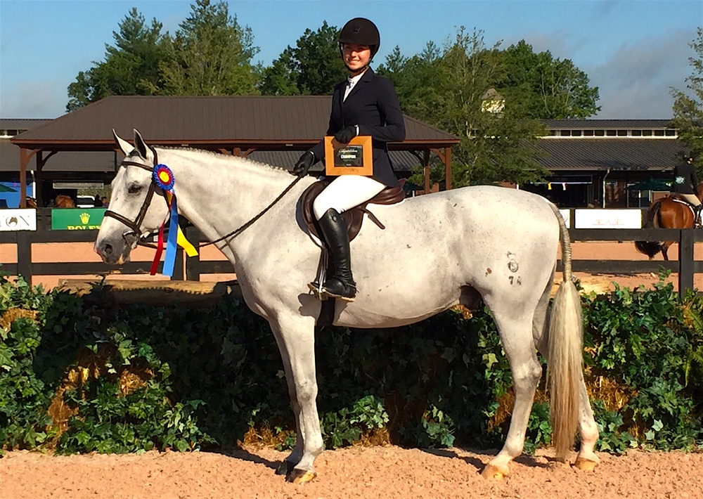 "In their first outing, Alexandra Maracic and her new hunter Lucky Times were champions of the 3'3""/3'6"" Amateur-Owner Hunters. Photo courtesy of Messenger Hill Farm."