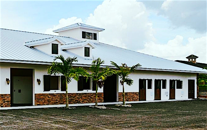 The property features grass paddocks and an arena with GGT footing and lighting.