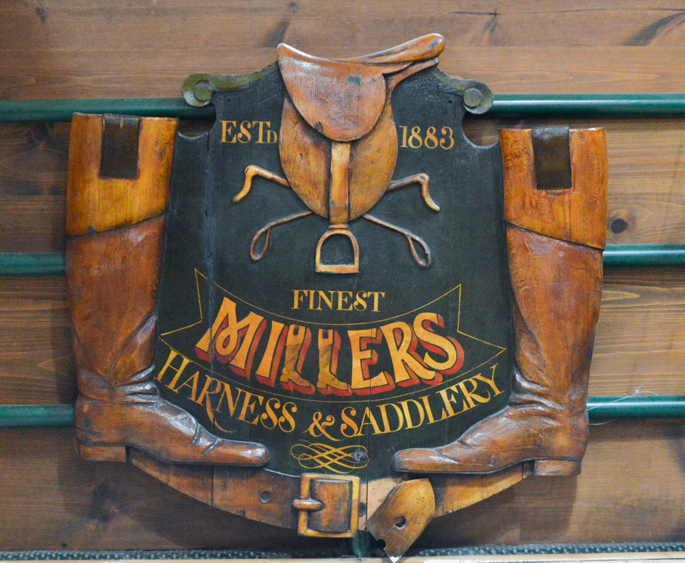 The original Miller's sign. Photo courtesy of Manhattan Saddlery.