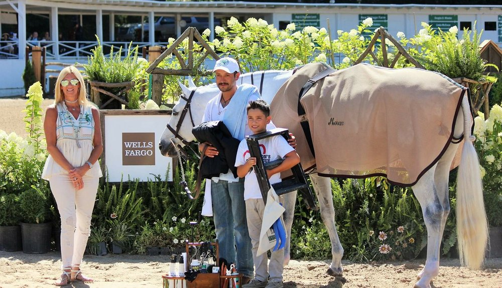 Meredith Fennen presented the award for Missy Luczak-Smith and Doug Smith to Daniel Gomez   with   his son Sebastion and Bacardi, owned by Caroline Moran. Photo by Catherin Cammett