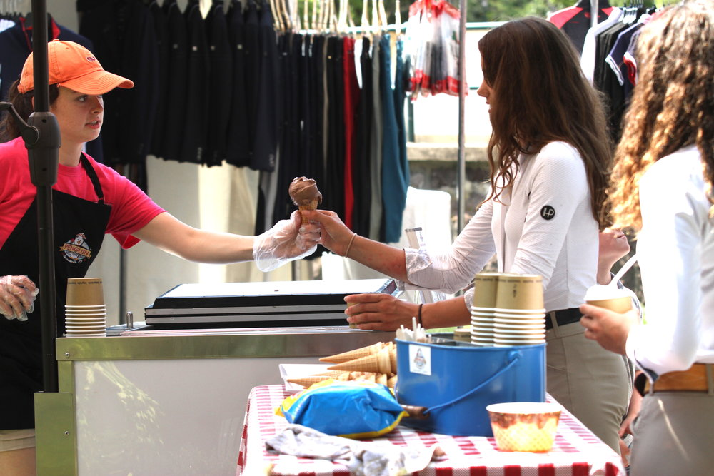 Manhattan Saddlery scooped up ice cream during Manhattan Saddlery Family Day.    Photo by EQ Media