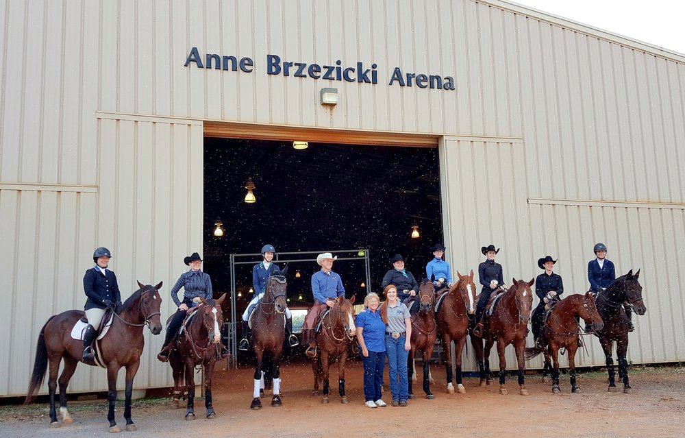 Anne Brzezicki with her student and successor, new director of equestrian programs and AQHA World Champion rider, Ariel Herrin, along with members of the MTSU Equestrian Team at the event. Photo courtesy of Rhonda Hoffman.