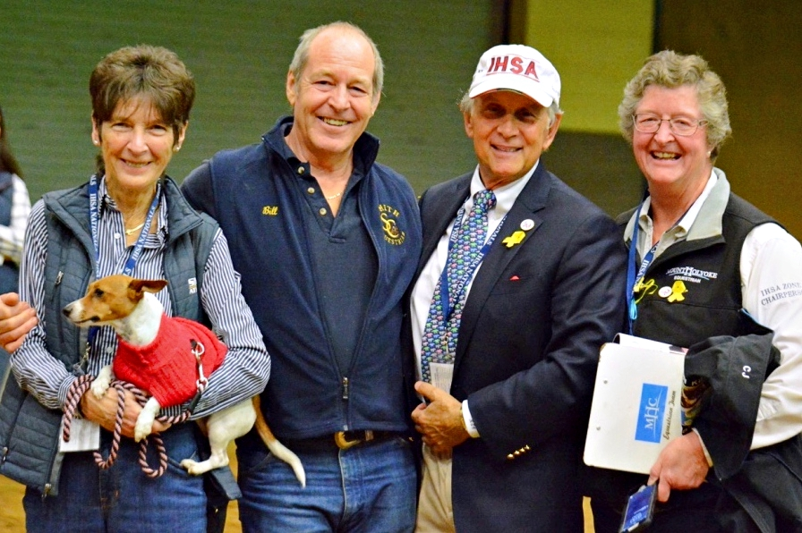 Sue Payne holds her dog Keeva with her husband Bill Payne, Bob Cacchione IHSA founder and executive director and CJ Law, Mt Holyoke IHSA coach and board member at Ithe 2017 IHSA Nationals Championship Show at the Kentucky Horse Park. Photo by Tyler VanVelsen