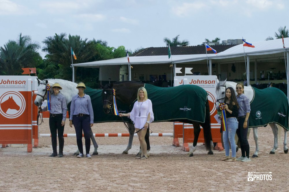 A few of East Wind's 2017 WEF Circuit Champions. Karoleena Low Adult Hunter champion with owner Christy Powell (not pictured) with assistant trainer Maggie Gould, Tiffany Morrissey, Calero and Susannah Rose (Adult Amateur Hunter), Ren Round Number and Catherine Wu (Adult Modified Jumper), assistant trainer/rider Lisa Funk. Photo by B. Giacin Photos