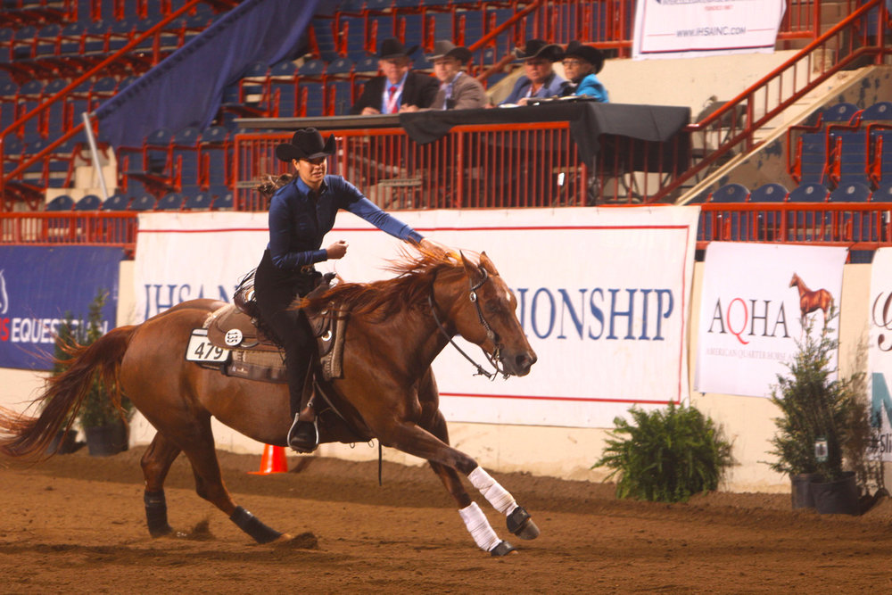 Kendall Woellmer competing at IHSA Nationals. Photo by  alcookphoto.com
