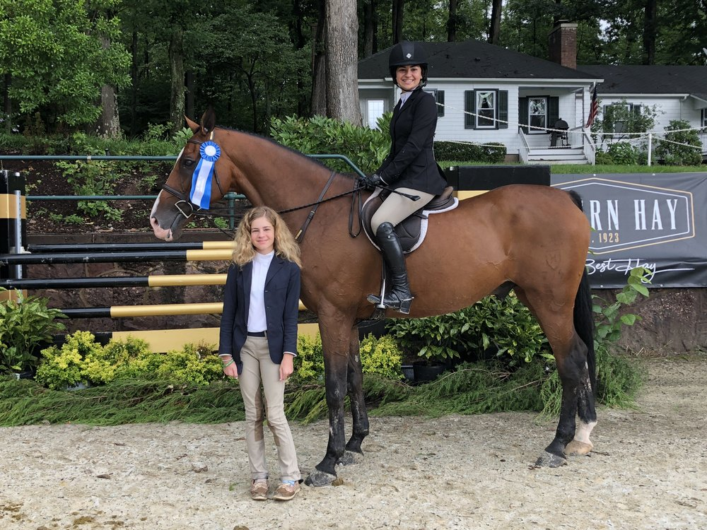 Sophia Chimenti poses with her sister Mia aboard Chocolat 15. The sisters each earned medals on the opening day of Monmouth at the Team. Photo by EQ Media.