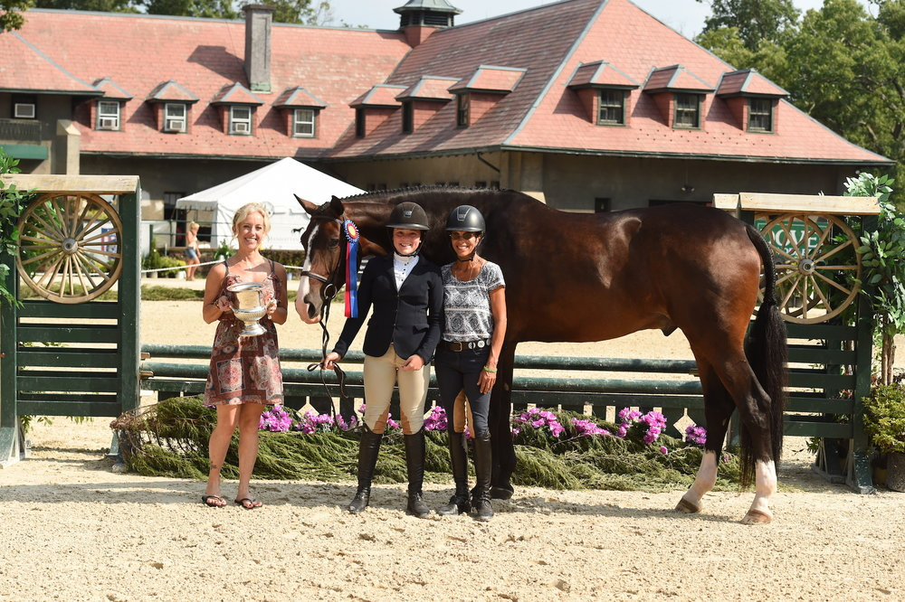 Liz Marano presents the award to Ella Witt and her trainer Leslie Verdi. Photo by Anne Gittins Photography