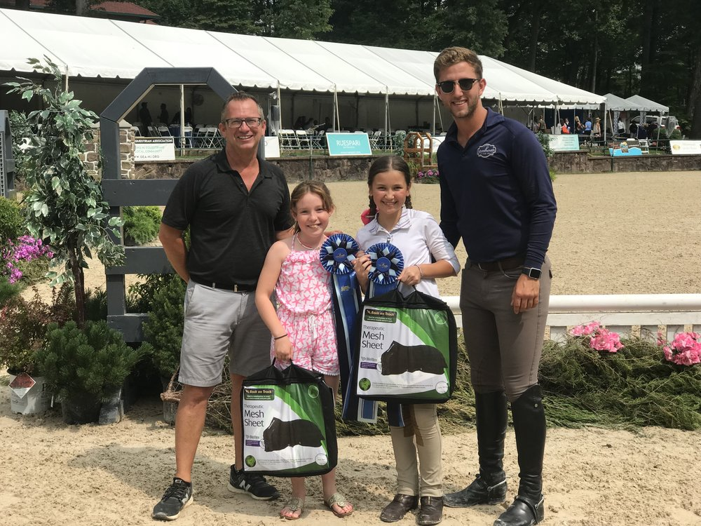 The judges presented Grace Sameth the Top Trip of the Day Award, sponsored by Stal de Eyckenhoeve. Jordan Rupich earned the Style of Riding Award, sponsored by Le Fash. Back on Track Therapeutic Mesh Sheets were awarded to the two riders. Both riders train at Windham Hill with Michael Dowling and Michael Meyers. Photo courtesy of Michael Dowling