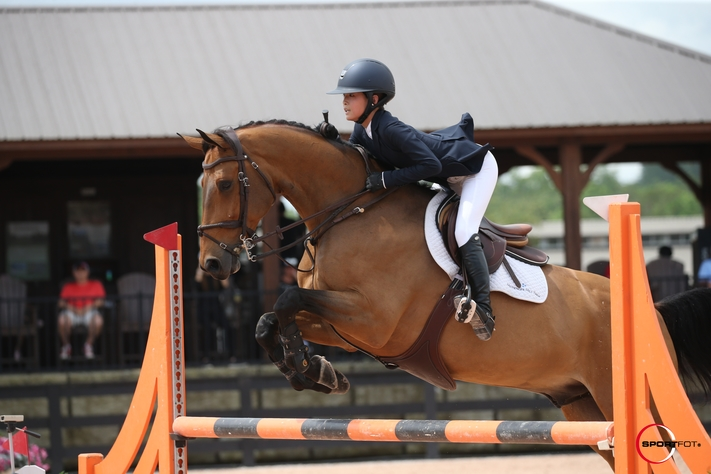 Chloe Jhin and Elmo V.D. Bremdhoeve earned three championships in the Children's Jumpers this fall. Photo by SportFot