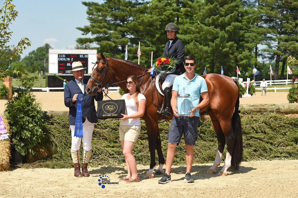 John Franzreb, Maxime Tyteca and Niels Haesen from Stal de Eyckenhoeve present the award to  Havens Schatt and Caemlyn Z, winners of the open section of the  $40,000 USHJA National Hunter Derby in 2019. Photo by Anne Gittins Photography