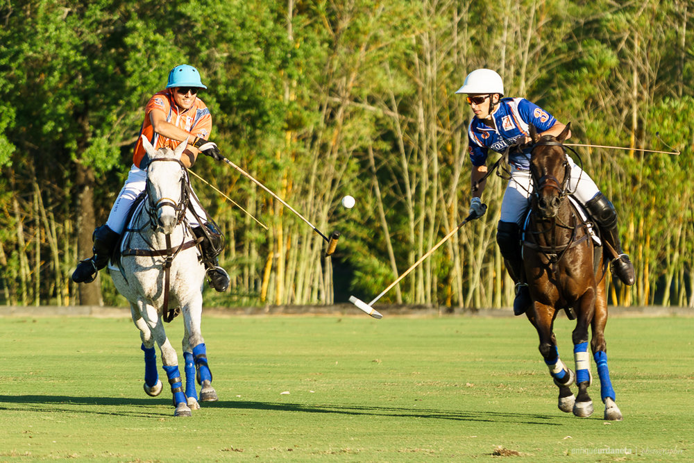 Wes Finlayson on the Provident Jewelry team (right)tries to keep control of the dribble with Benjamin Avendaño from GJ Racing putting on the pressure.