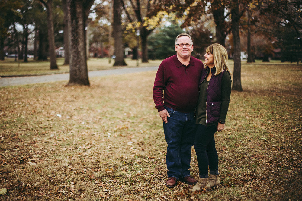 candid moment of husband and wife during family photo sessions in Columbus, Indiana