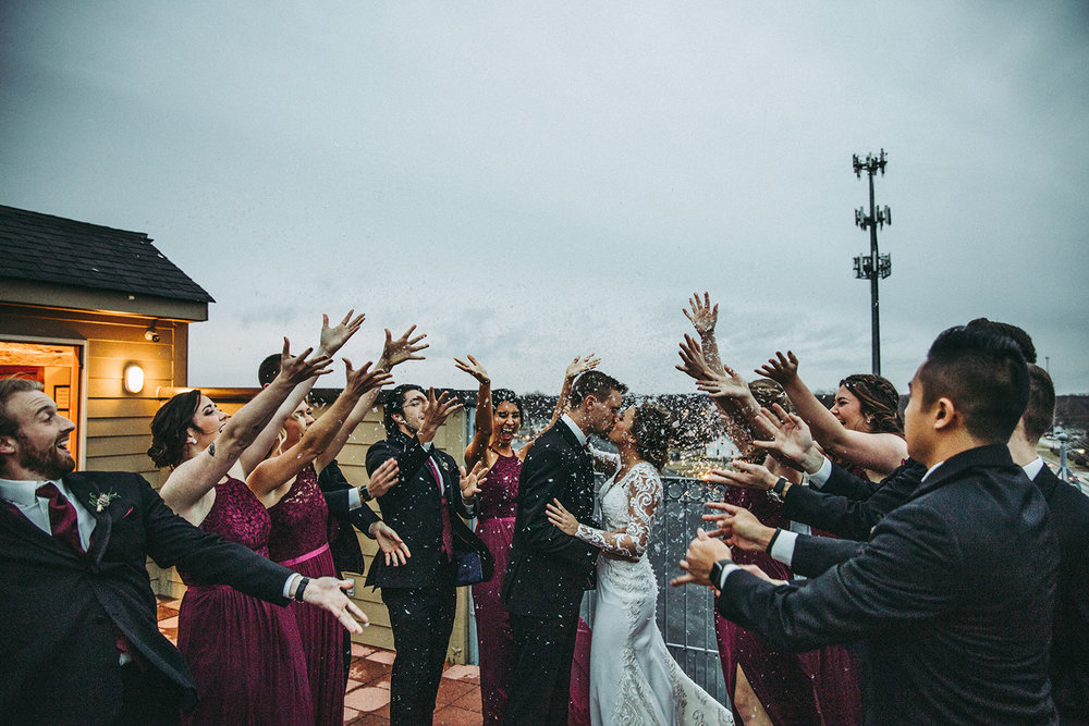Wedding party in winter wonderland on the rooftop of the Mill Top Banquet and Conference Center in Noblesville, Indiana