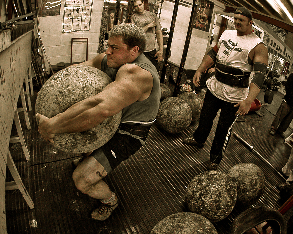 Think this dude complains when someone tells him to lift a bigger rock?  No.  He just does it.