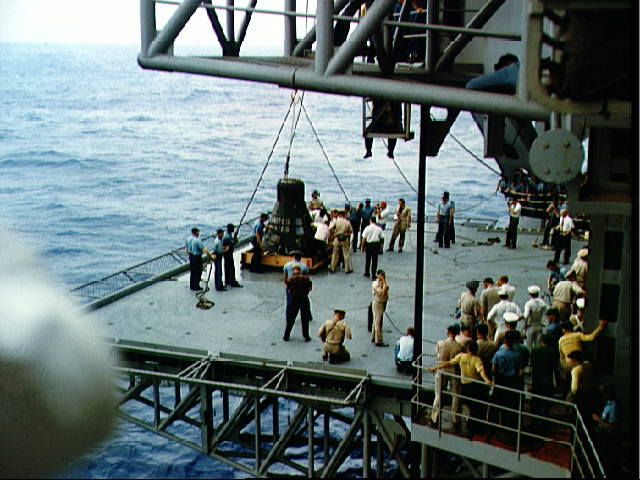 Faith-7-touches-the-Kearsarges-deck-with-Cooper-aboard.jpg