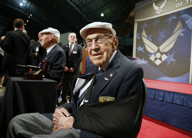 """Two members of the Doolittle Tokyo Raiders, retired U.S. Air Force Lt. Col. Richard """"Dick"""" Cole, seated front, and retired Staff Sgt. David Thatcher, seated left, receive the Congressional Gold Medal (photo from Associated Press)"""