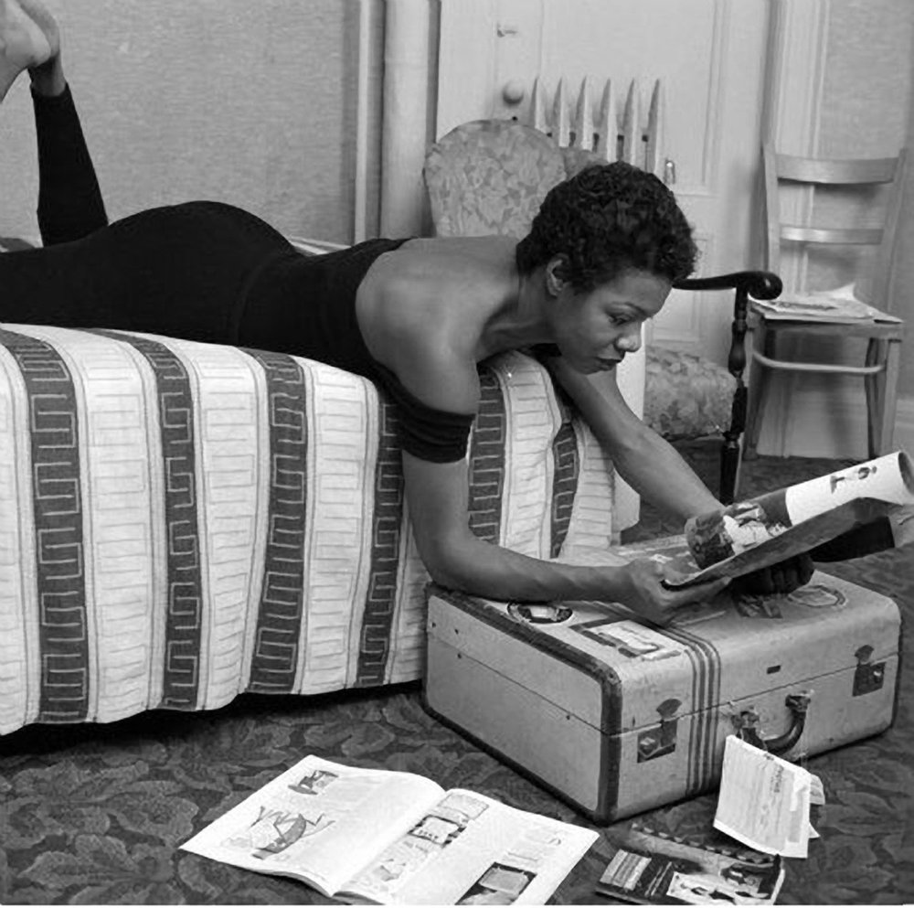 Maya Angelou reading in her dressing room before a performance at Village Vanguard in New York