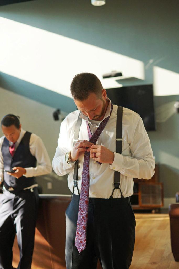 groom_putting_on_tie-683x1024.jpg