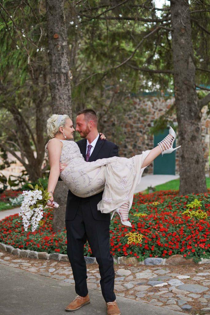 groom_carrying_bride-683x1024.jpg