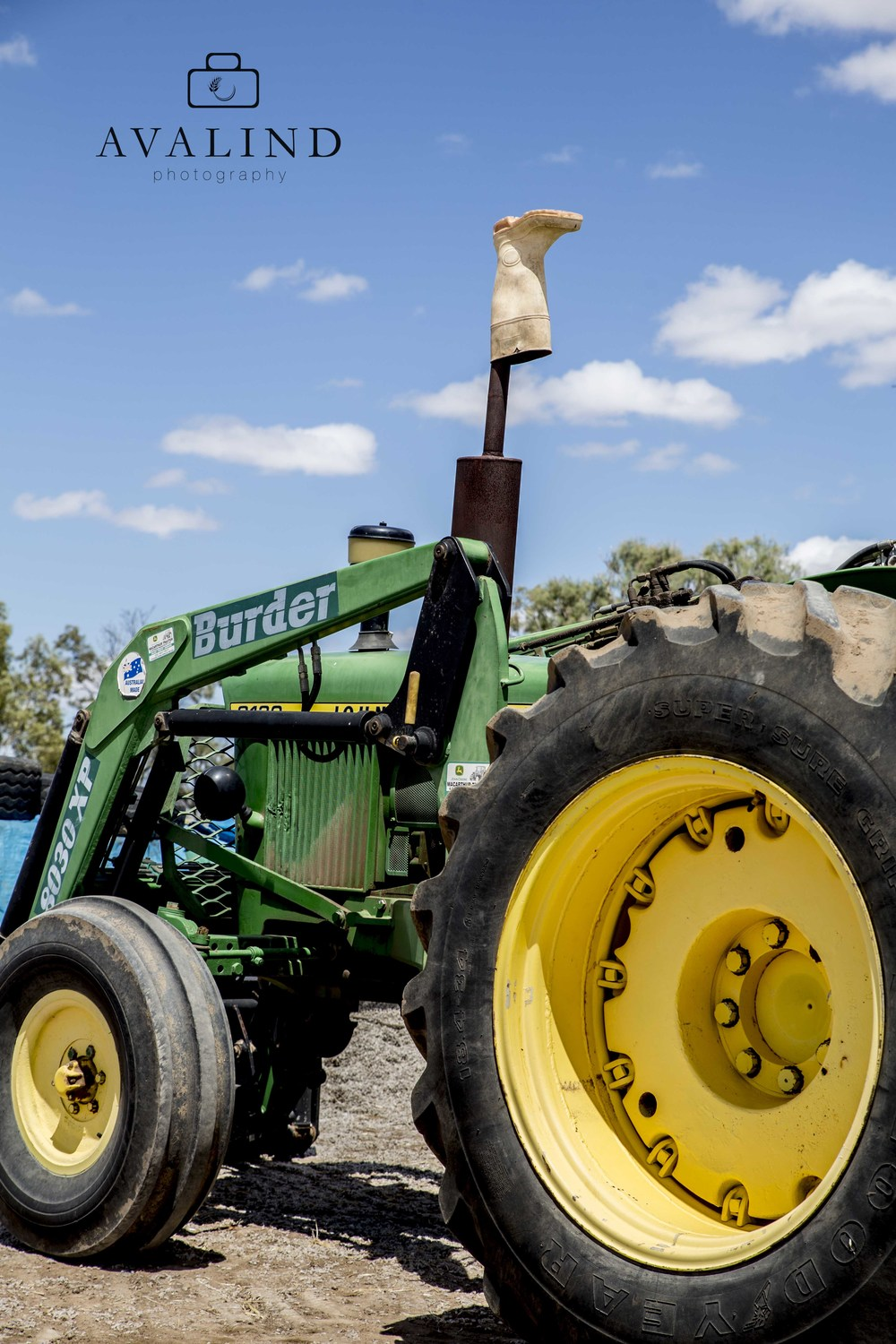 Don's tractor. A symbol of hope, the gumboot is there to stop any rain from going down the muffler...