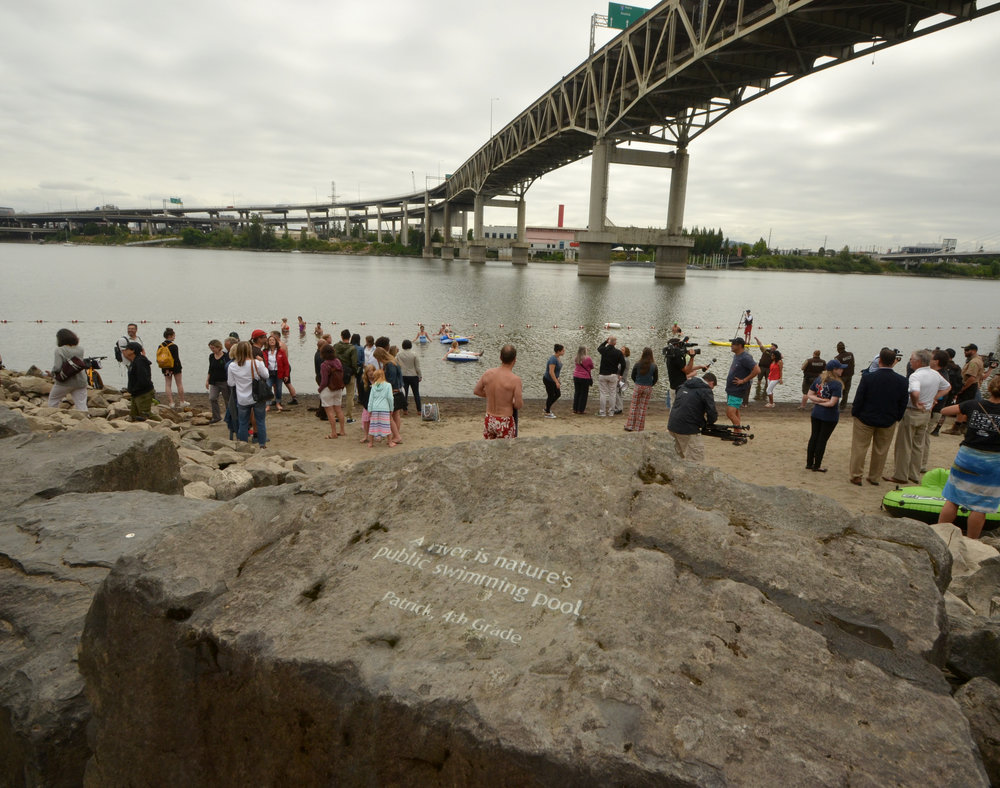 One of the Honoring Our Rivers student poems engraved in stone at Poet's Beach by a fourth grader named Patrick.