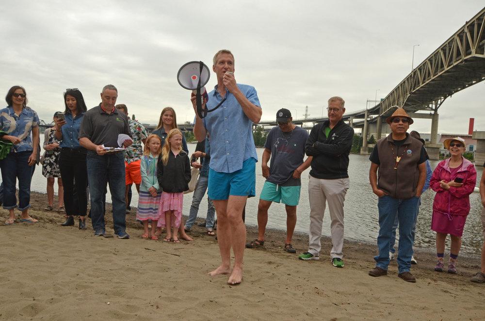 Portland Mayor Ted Wheeler kicks of the Poet's Beach First Splash between legislative sessions.