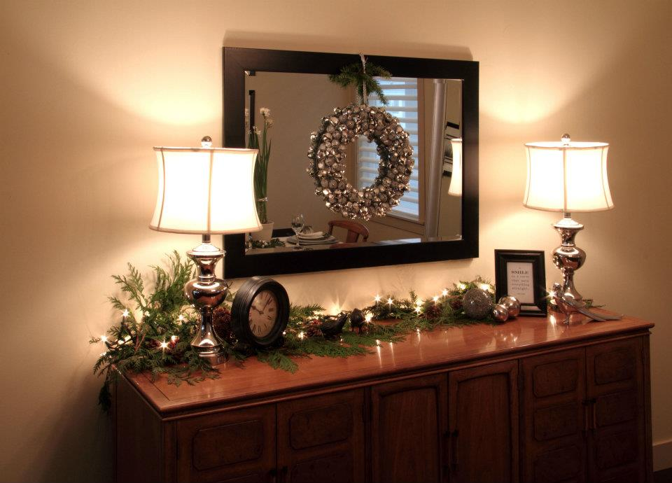 Fresh greenery, paired with a warm mini-lights and silver and black accents gave this home a refined Christmas glow.