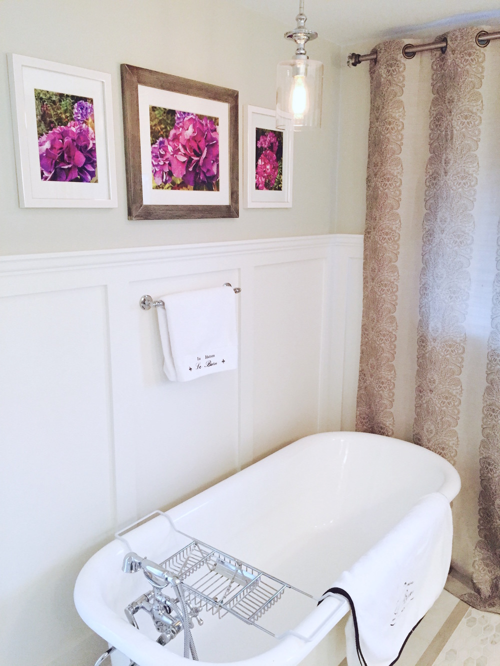 The existing clawfoot tub was refinished and a new faucet was installed to make this once neglected bath shine again.