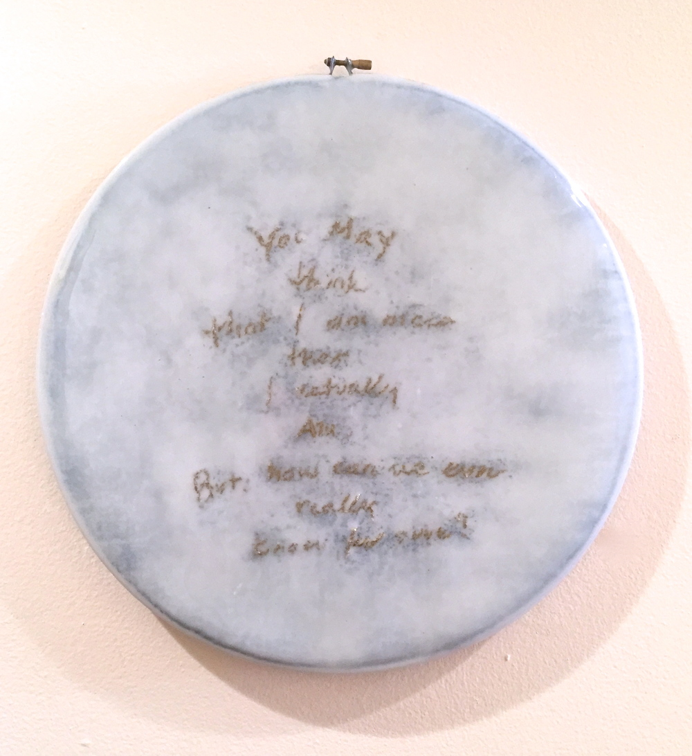 """You may think that i am nicer than i actually am, But how can we ever really know for sure?   Gold thread needlework and resin on stretched linen form.  !4"""" in diameter  $1600"""