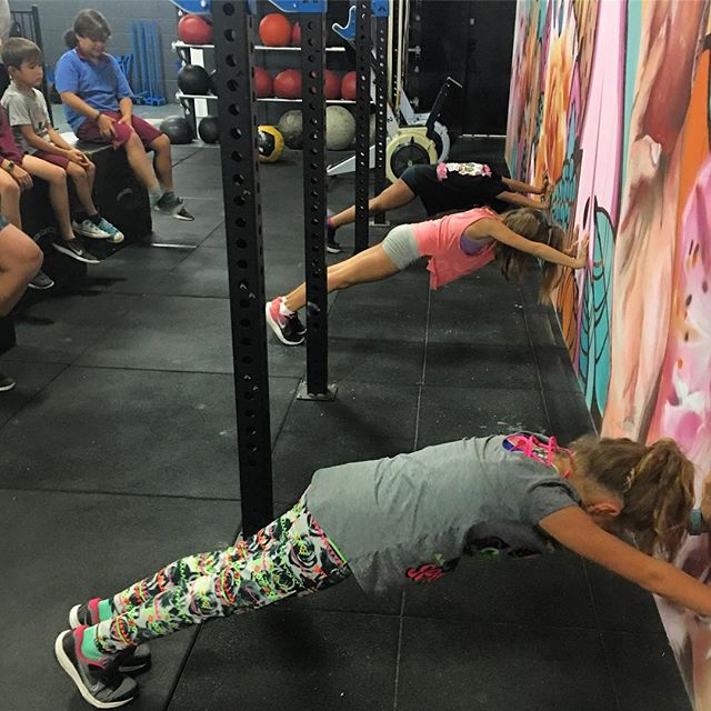 """This month the kids are ALL about the push-up and a SOLID core. """"So much of what we do in CrossFit, or any movement task for that matter, requires good stabilisation of the middle of our bodies so that we can move efficiently with the arms and legs.  Working on """"plank"""" and subsequently, the push up, is a very effective way to develop body awareness for stabilisation of our middles. As we move into the inverted position of a handstand, we can also build stability and control around the shoulder joint"""" ---- #progress #balance #integrity #opportunity #enjoyment #crossfit #fitkids #brisbane"""