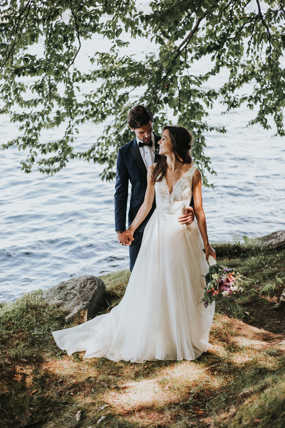 Bride and groom lakeside at Muskoka wedding by the lake