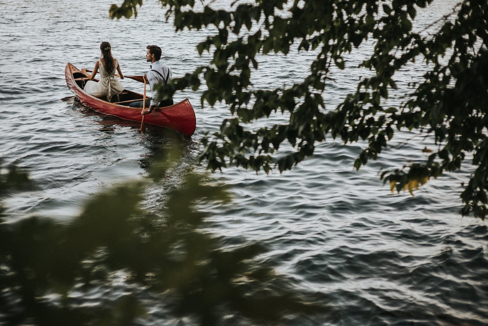 Bride and groom in canoe for couples photos in Muskoka