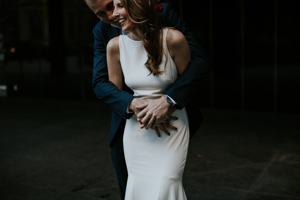 Bride and groom cuddling at downtown Toronto wedding