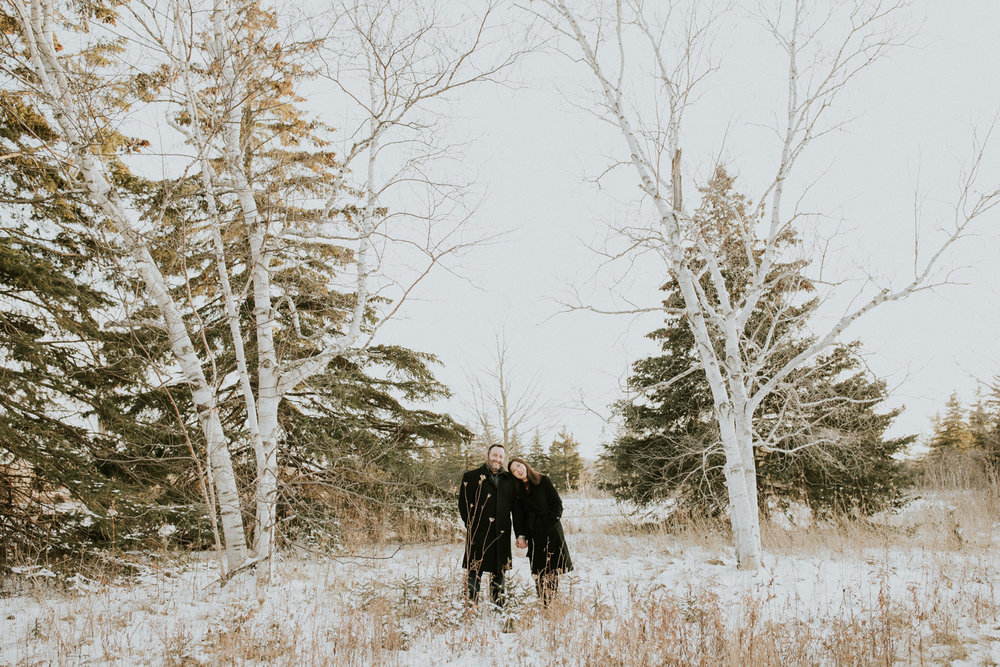 happy couple at out door winter engagement photography session