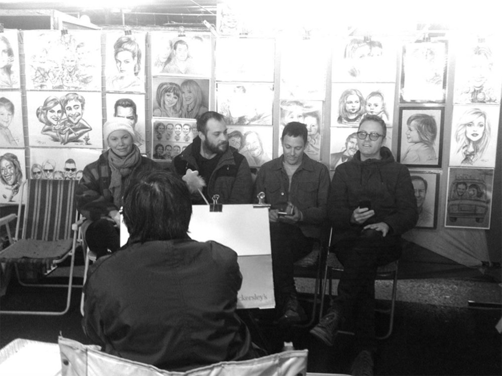 QVM caricaturist Peter Wen draws Biennial Lab artists Sanne, Jamie, Jason and Kiron. Photo: Lynda Roberts.
