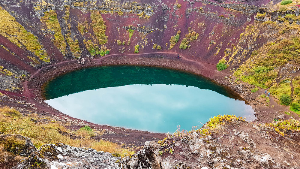 Kerið   is a  volcanic crater  lake located in the Grímsnes area in south  Iceland , along the Golden Circle.