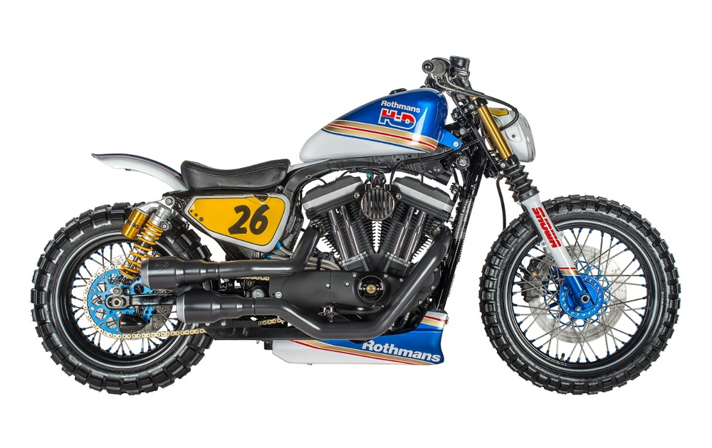 The Rothmans Scrambler is yet another example of how the Sportster works as a platform for so many styles. The only limitation is the builder's vision. The client for the Rothmans Sportster was inspired by the Martini twins that the Speed Shop previously built. The 1970s motorsport-themed bike features: RSD bars, risers, levers and derby cover; Shaw Speed provided the timing cover; wheels are by Shaw Speed too. It's got a final drive chain conversion, forks are Harley but shocks are Ohlins. Tank is stock Harley with Rough Craft gas cap, air breather is also by Rough Craft and paint is by Image Design Custom.