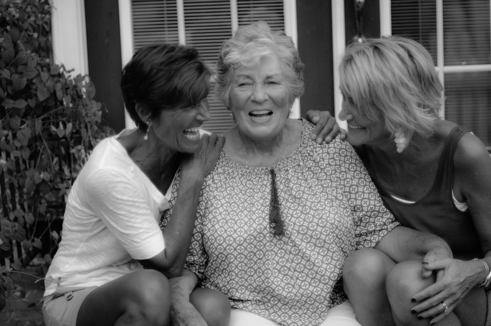 laughing with her daughters.jpg