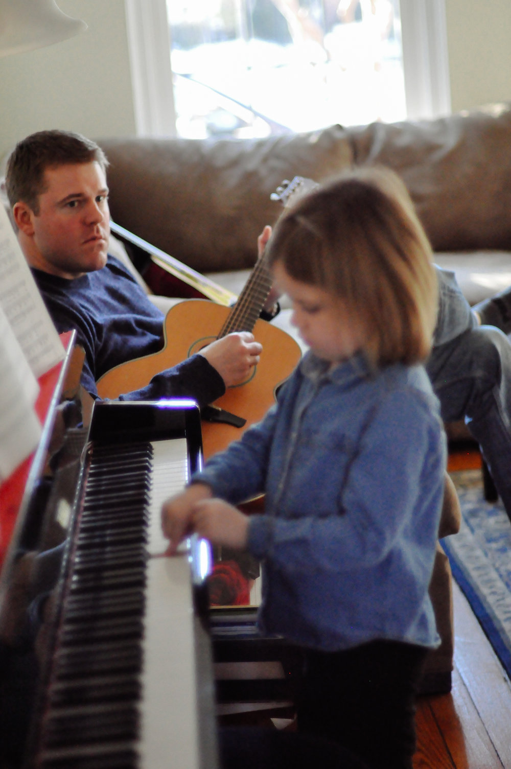 playing music with her dad