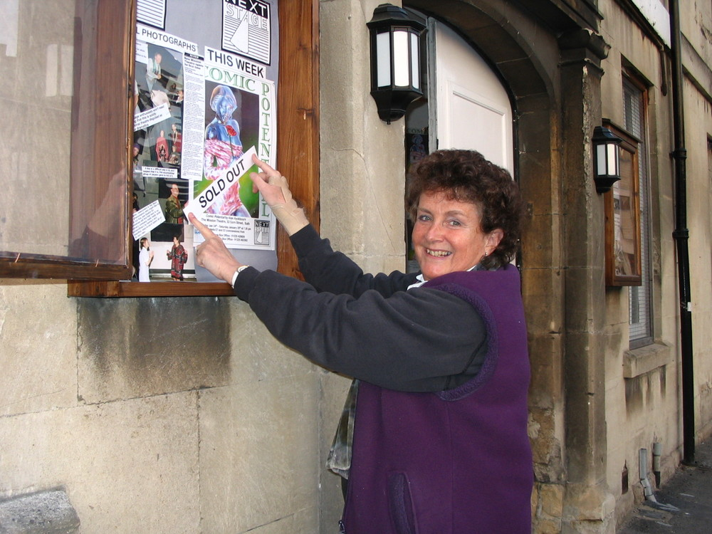 Artistic Director Ann Ellison putting up the first 'sold out' sign for The Mission's inaugural show