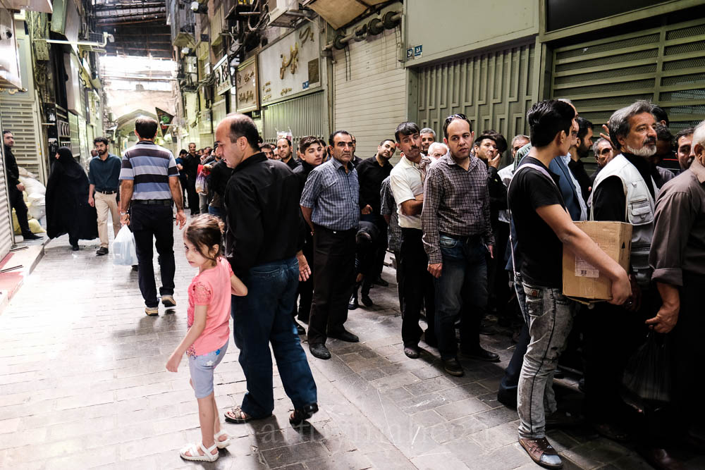 Tehran's grand Bazaar was closed during the last few days of Muharram. These long ques however were for hundreds of people waiting to get their share of the holy food. It is believed that if you eat this food (usually rice, lamb stew), your worries and stresses would be cured.