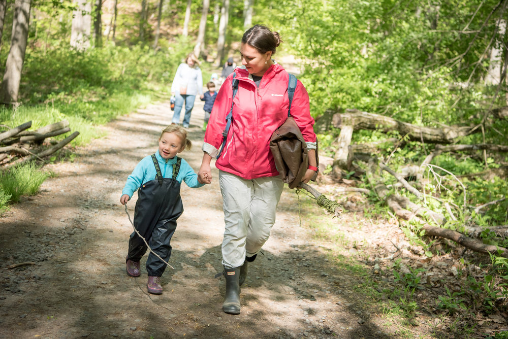 Mary Clair Sonneman with her younger daughter walking on a trail to main camp.