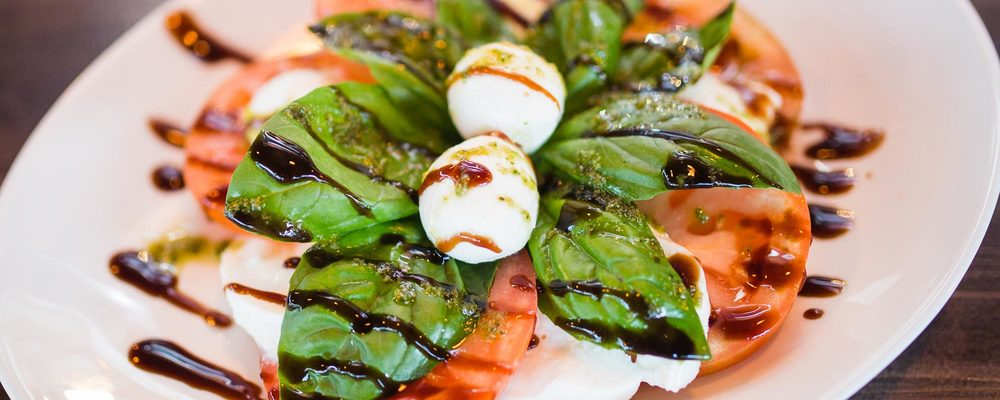 CAPRESSE  (Tomato, bufala mozzarella and basil reduction)